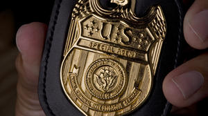 ncis_badge_in_hand